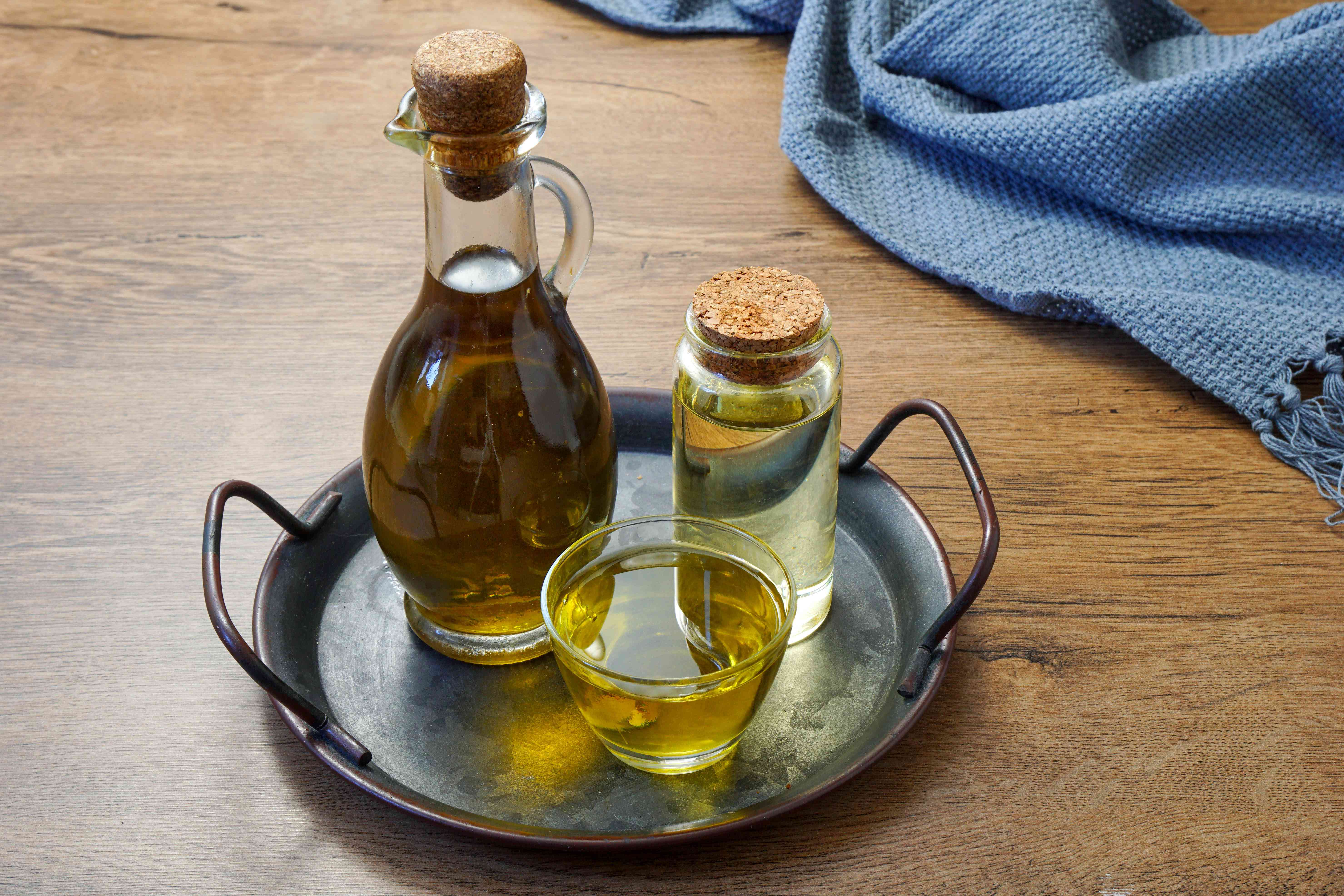 glass containers in metal tray containing different types of carrier oils