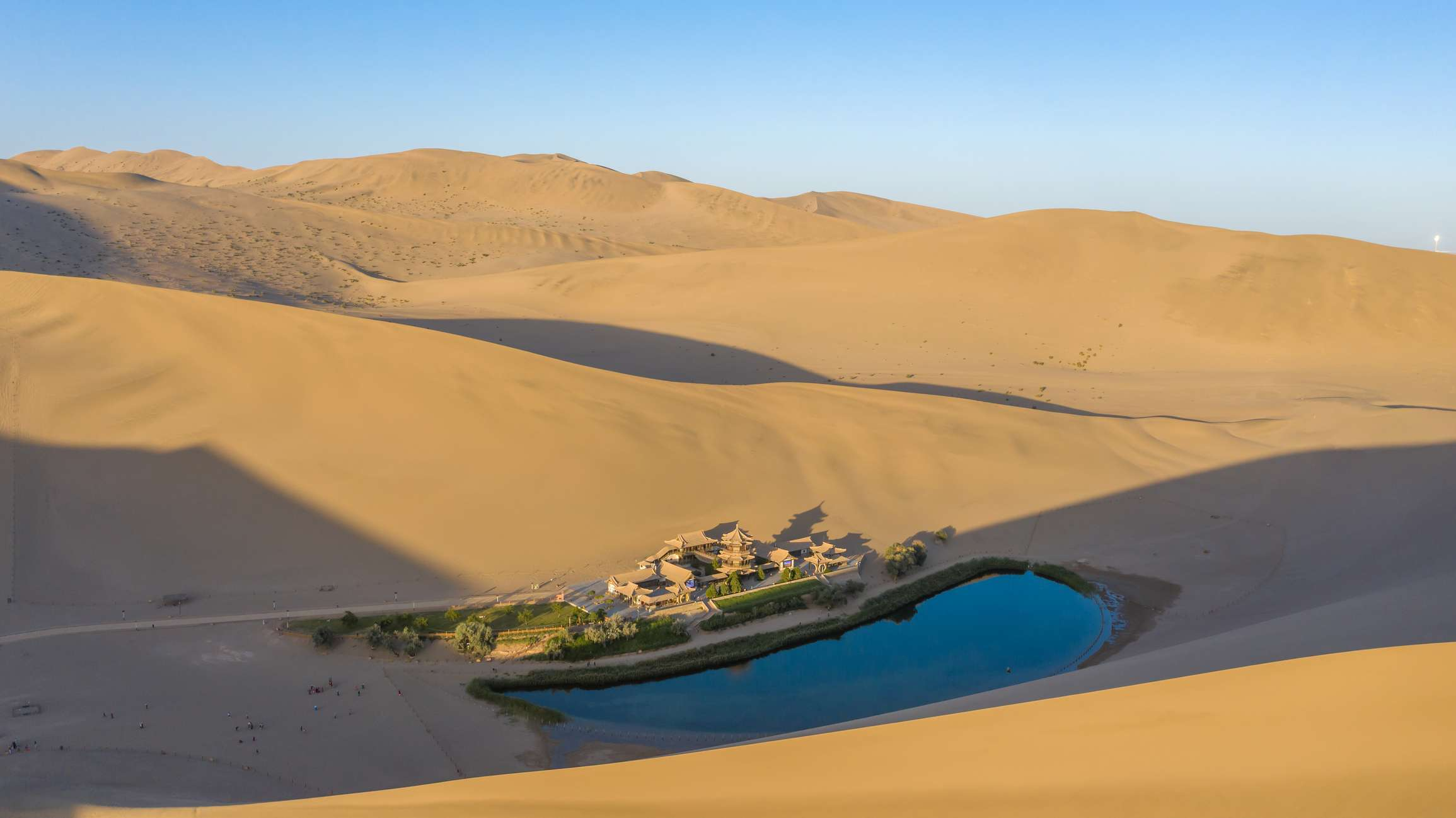 Crescent Lake, a small crescent-shaped lake in China surrounded by sand dunes