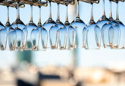 Wine glasses hanging upside down on racks