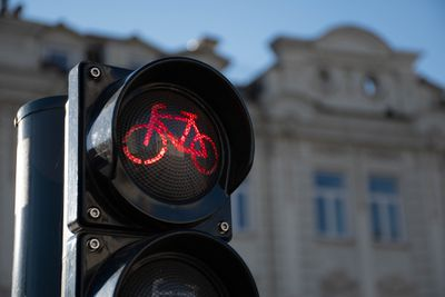 A red light for bikes to stop in an urban setting.