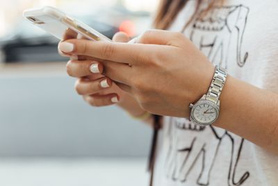 Young woman's hands holding a smartphone