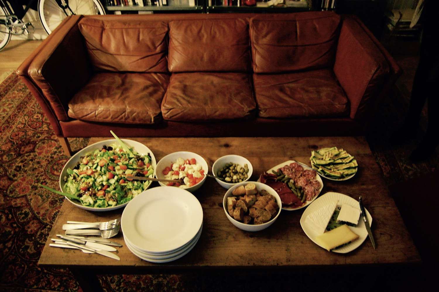 couch with dinner in front of it