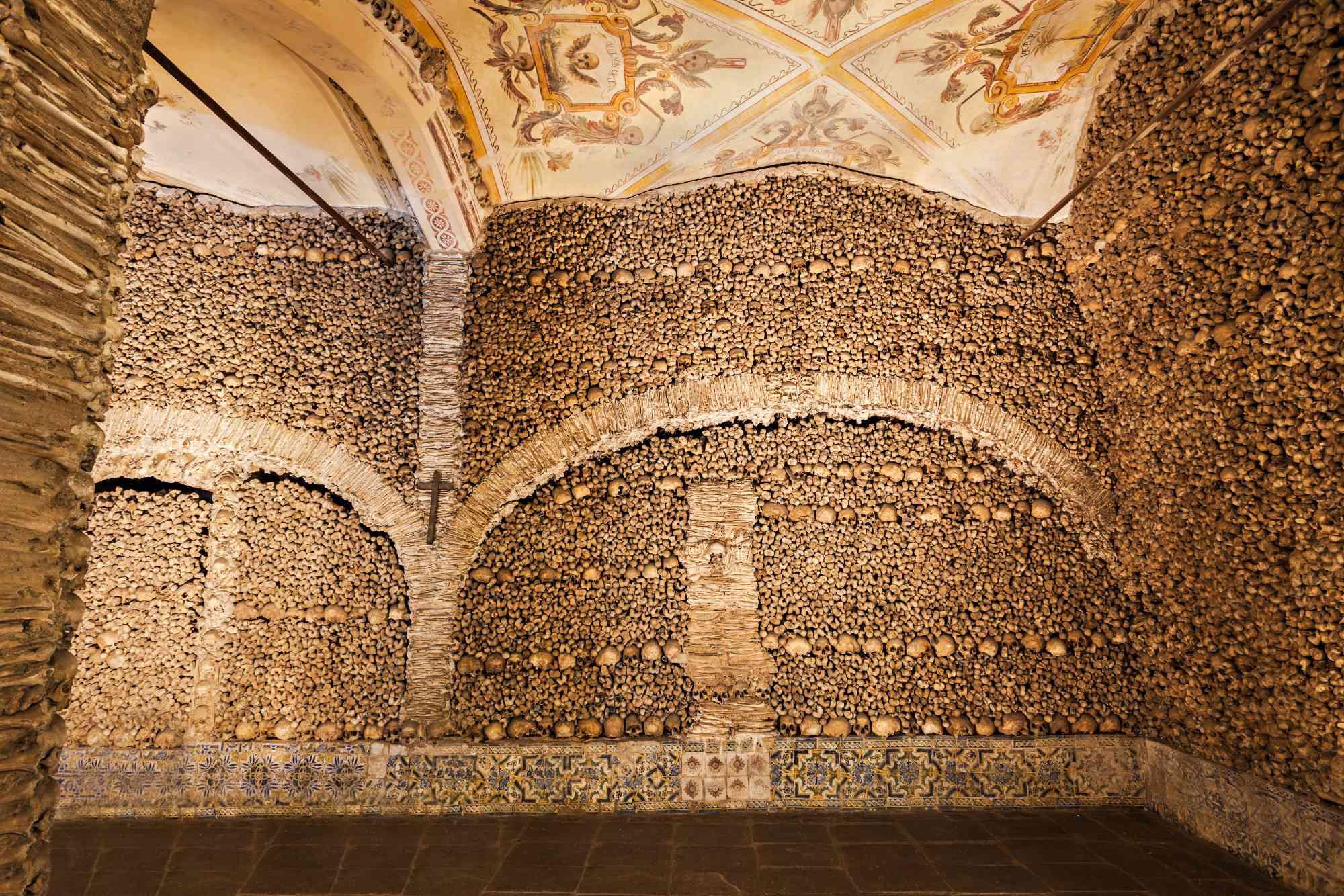 An elaborate display of bones and skulls form the walls of Capela dos Ossos in Peru