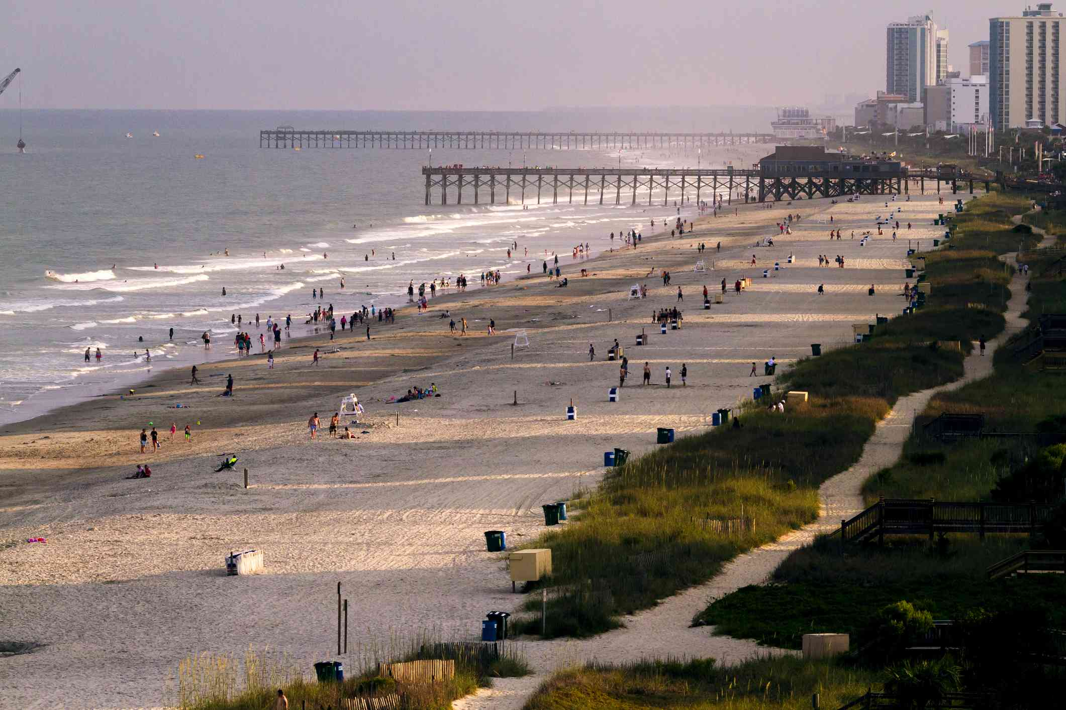 Busy Myrtle Beach with piers and buildings in background
