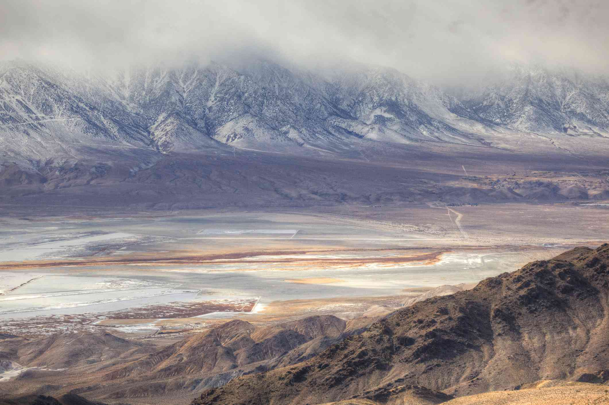 Elevated view of a dry Owens Lake with snowy mountains