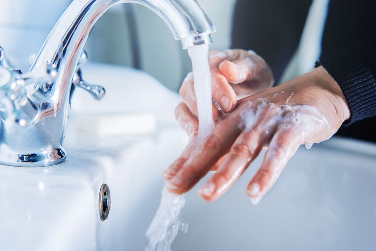 Person washing hands in a sink