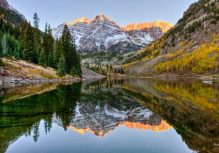 Mountain sunrise reflected on lake