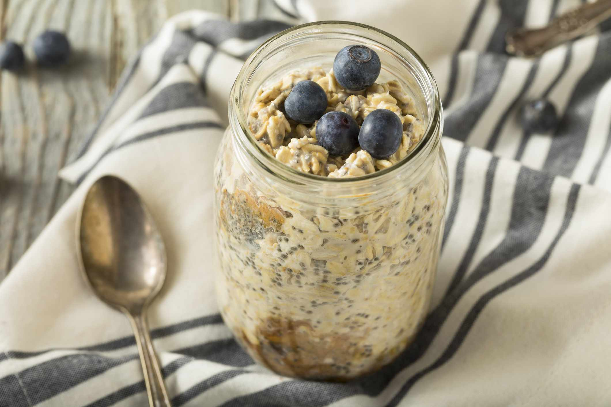 Overnight oats in a mason jar and topped with blueberries