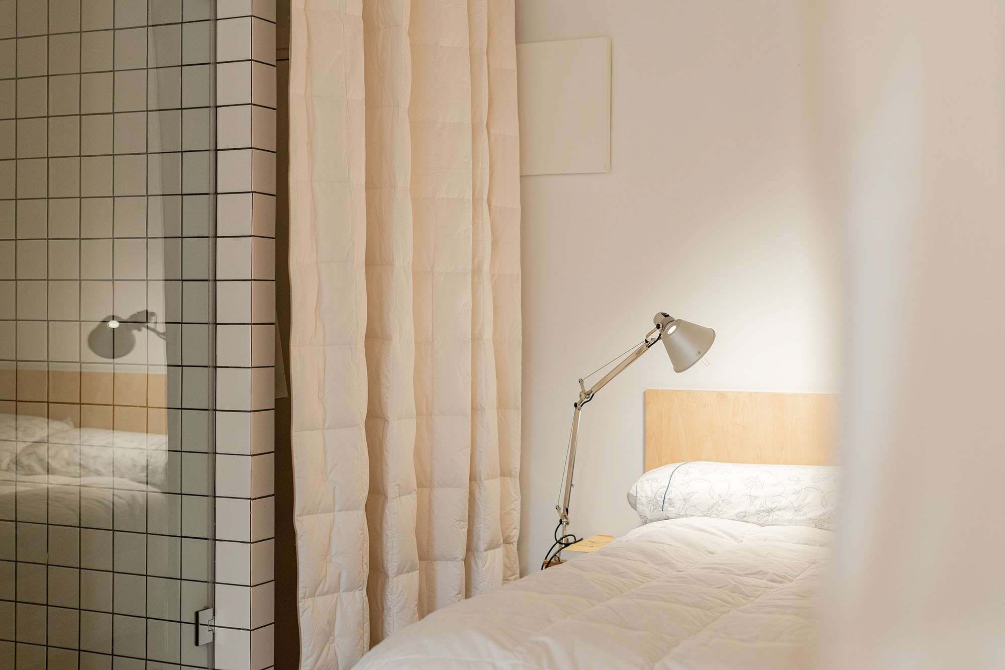 JM55 microapartment renovation by BURR Studio bedroom