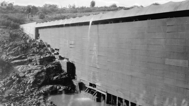 The reinforced steel and concrete of the Ashfork-Bainbridge Steel Dam is shown in this black and white photo
