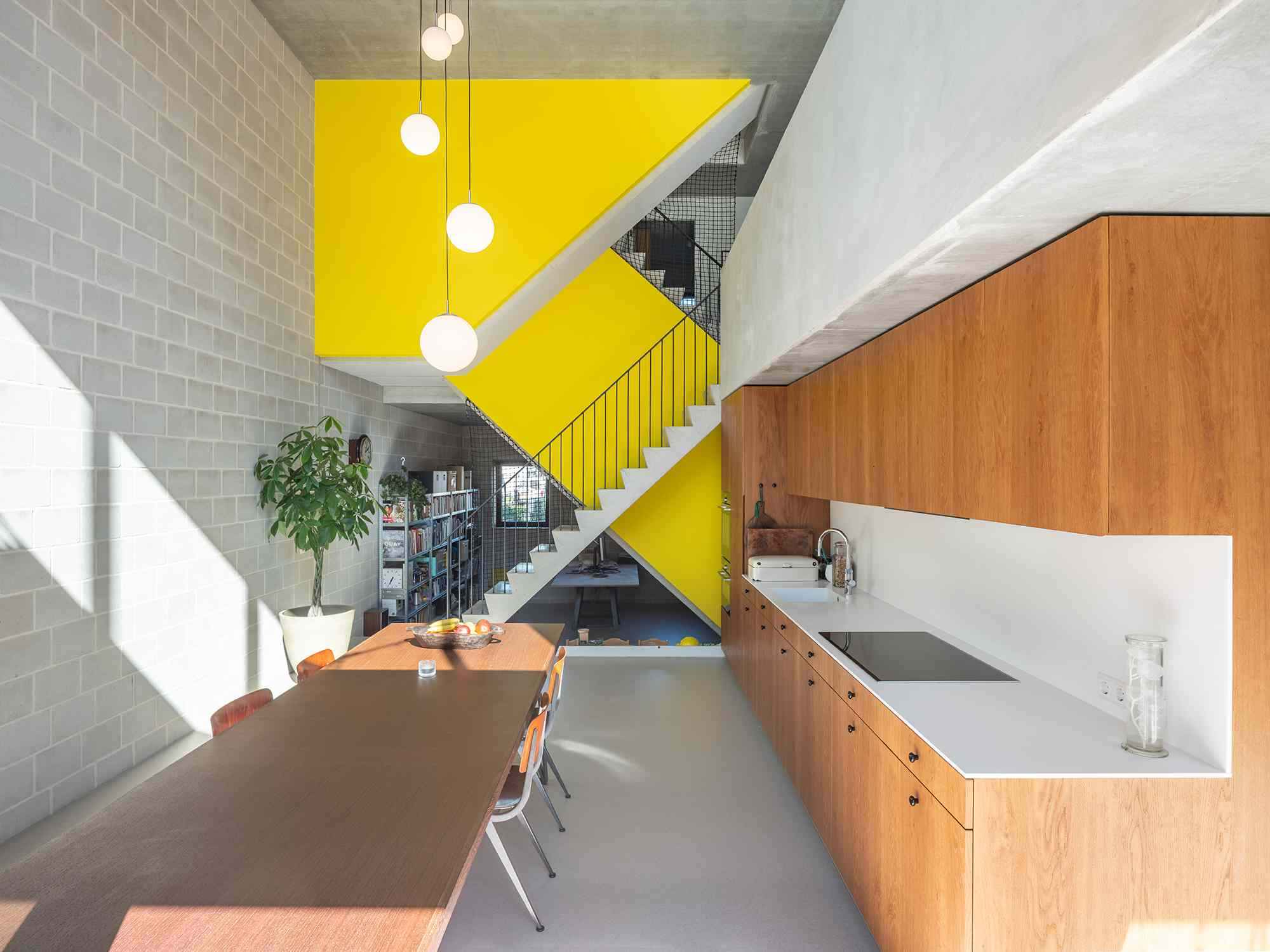 Three Generation House by BETA yellow main staircase