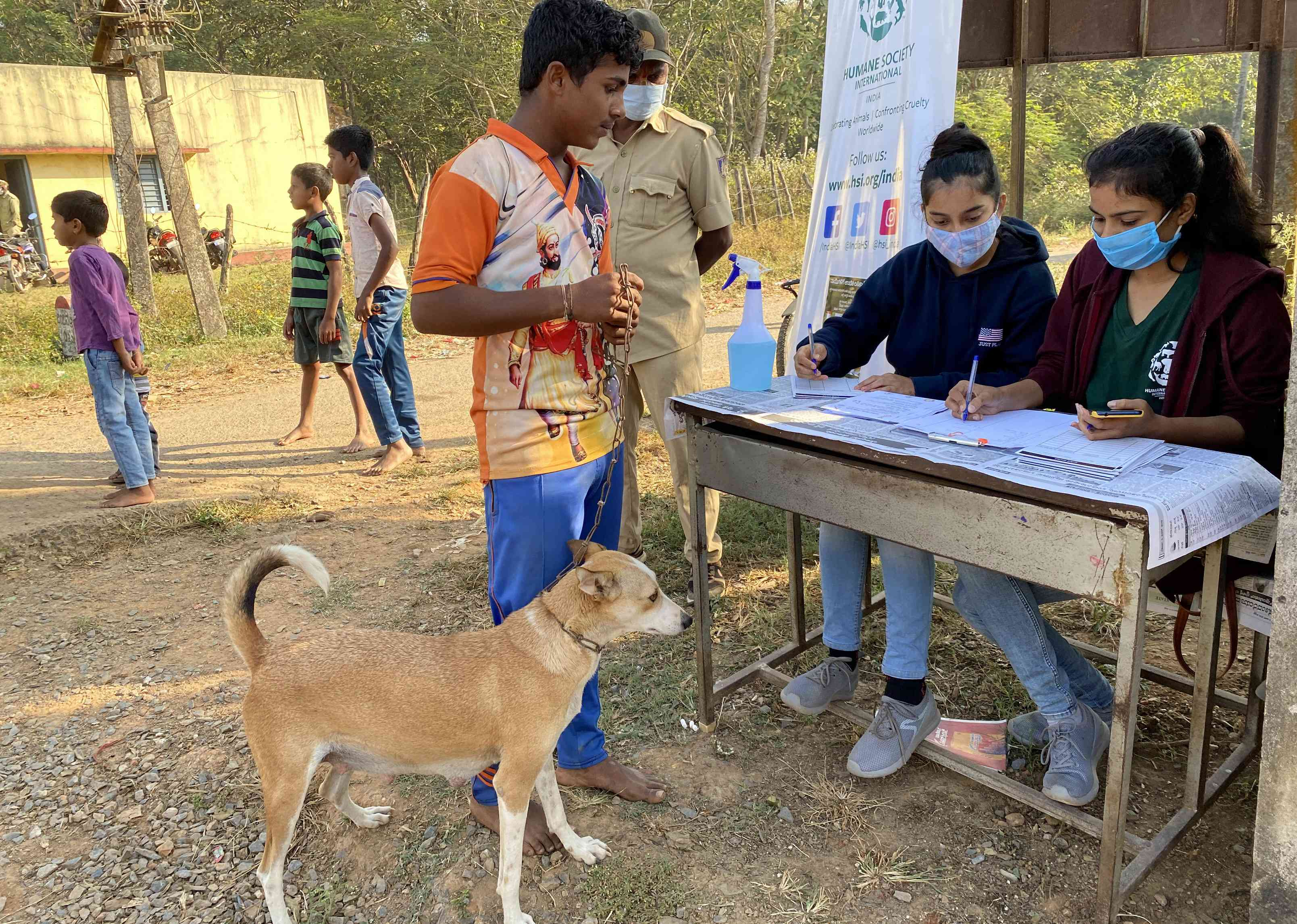 dog owner visits rabies clinic in India