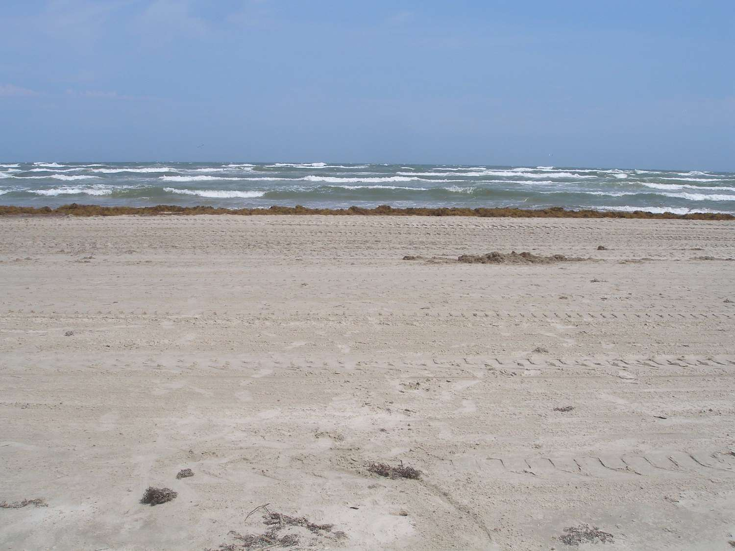 A head-on view of the sandy beach and choppy water at Padre Island National Seashore