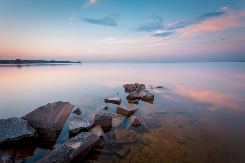 Use a slow shutter speed to turn moving water into a calm surface.