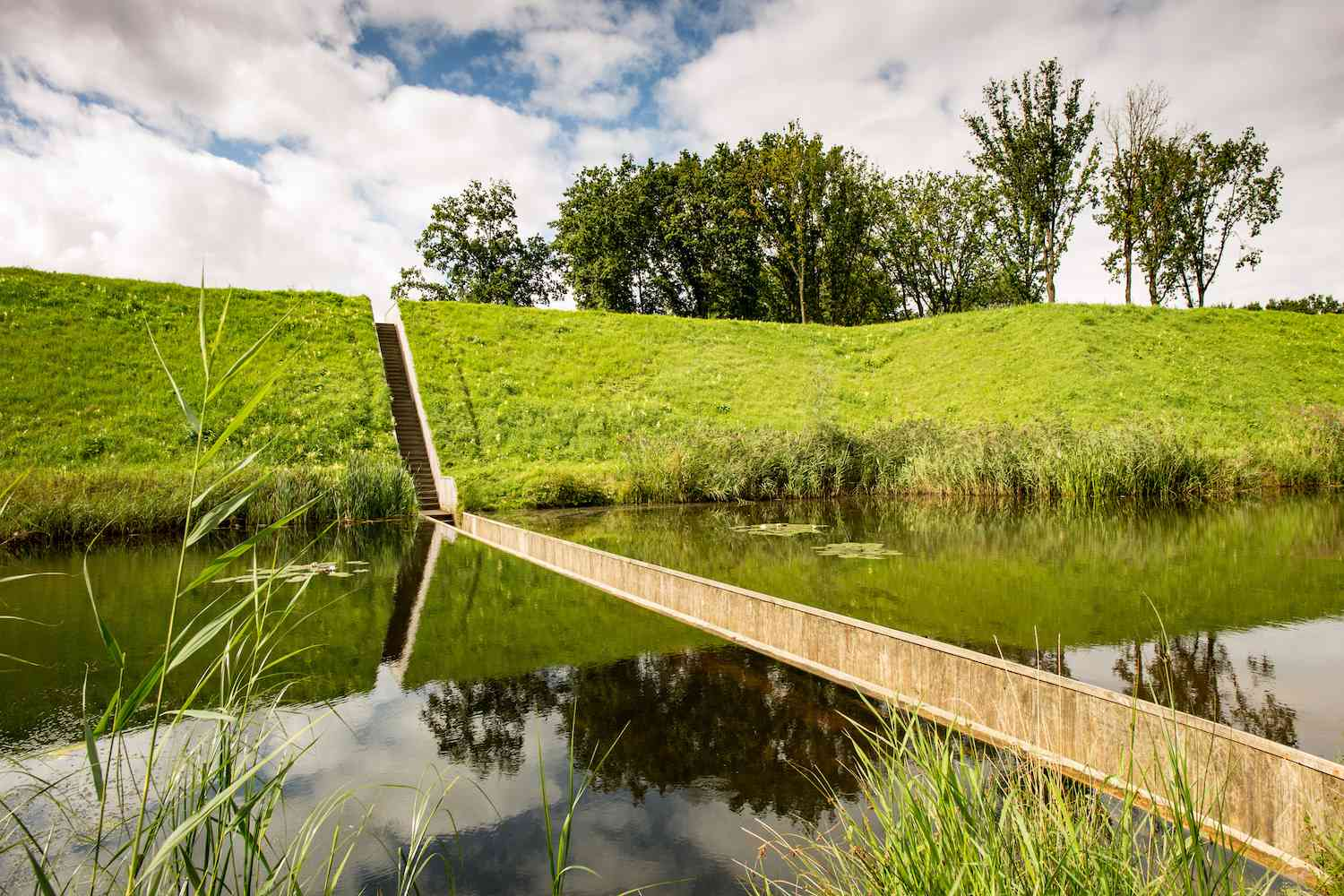 The Moses Bridge cuts through the water of a moat in the Netherlands