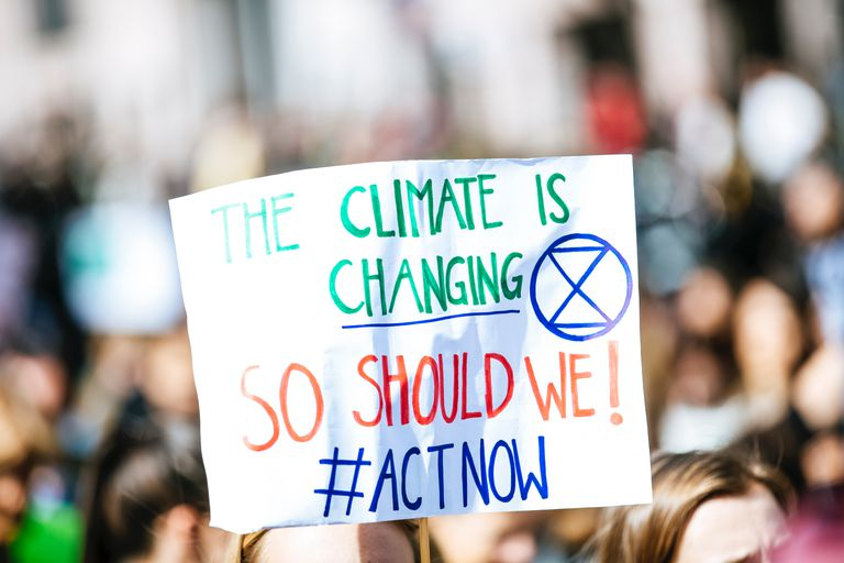 "Sign that reads ""The Climate is changing. So should we!"""