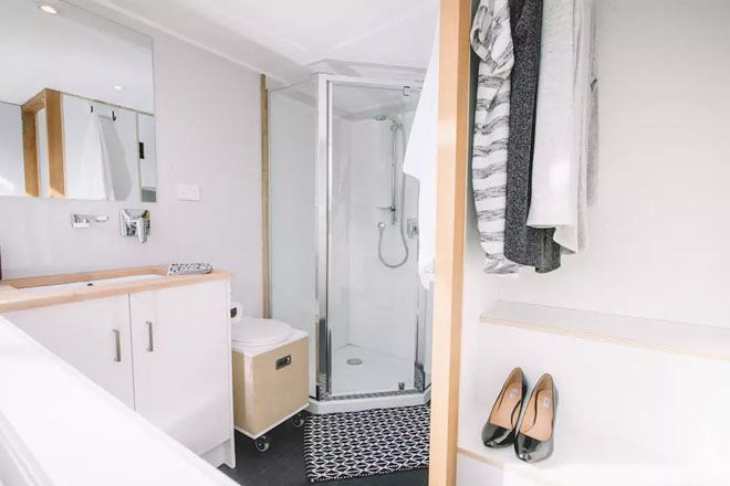 Shower, toilet, and sink in the bathroom