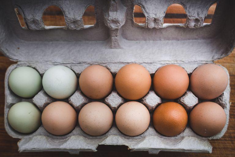 Open carton of a dozen white and brown eggs