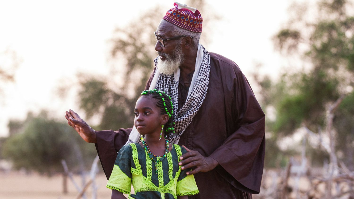 elder with child working on Great Green Wall