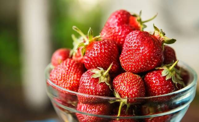 strawberries in a glass bowl