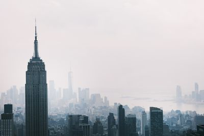 The Manhattan skyline continues to sit under a haze on July 21, 2021 in New York City. According to data from the National Oceanic and Atmospheric Administration, wildfire smoke from the west has arrived in the tri-state area creating decreased visibility and a yellowish haze in many areas.