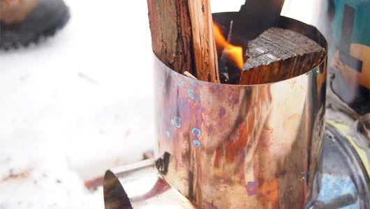 A rocket stove buring wood