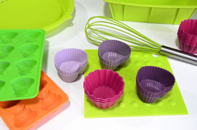 Silicone kitchen implements and bakeware in bright colors