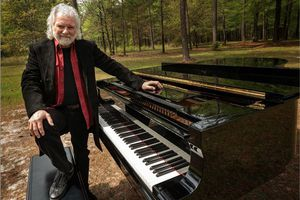 Chuck Leavell and piano in the trees