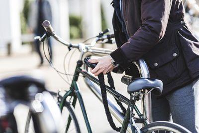 Woman locking bike to rack