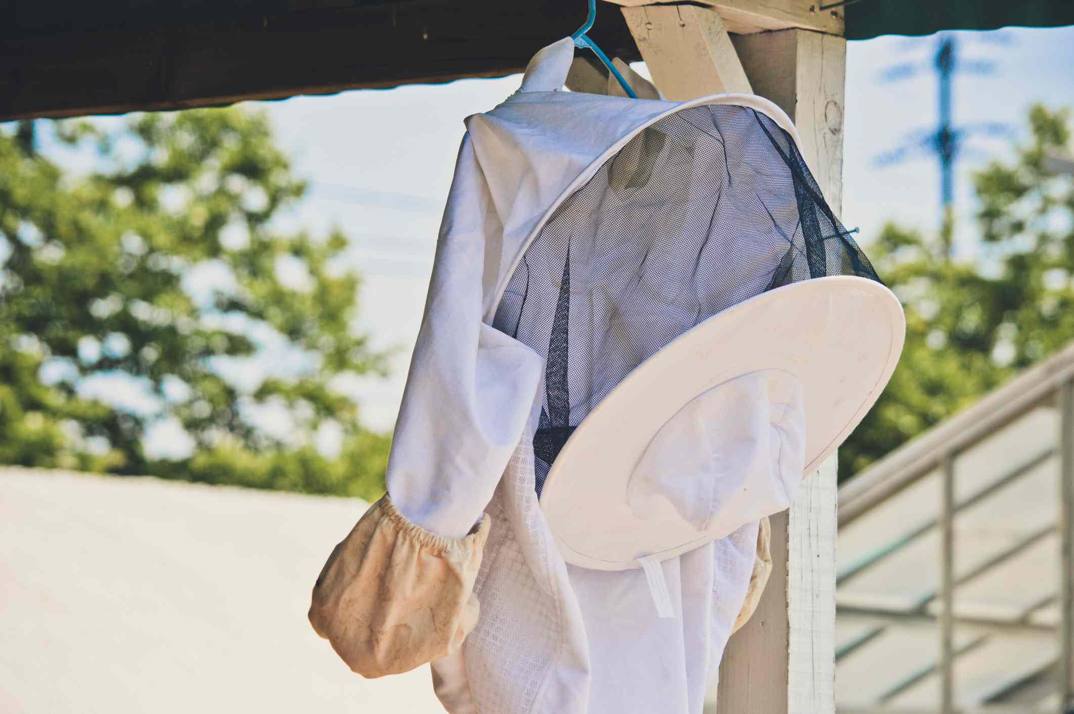 Beekeeper suit hanging outdoors