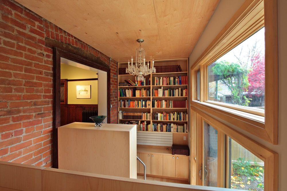 wood walls and a book case