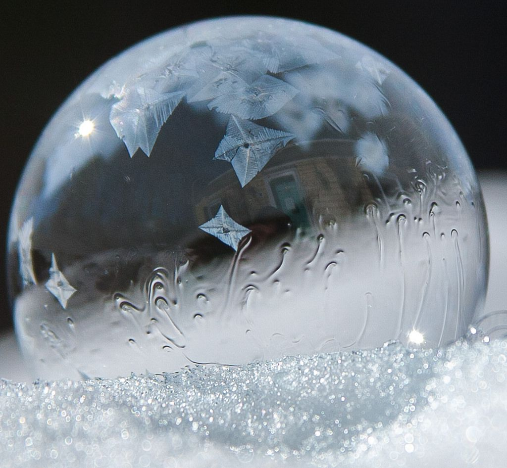 Star-like ice crystal formations on a frozen soap bubble.