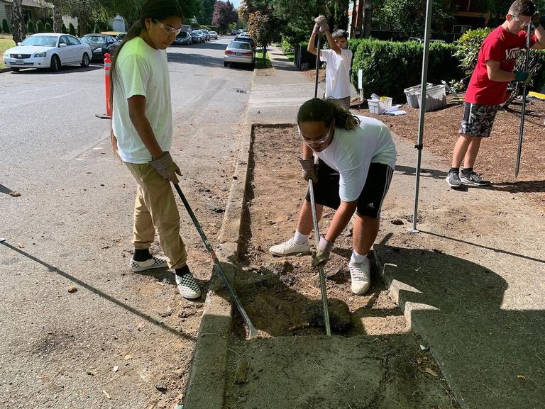 Depave kicked some serious asphalt with some teens at the Siletz Tribal office as they re-indigenized a planting strip by making way for native medicinal and cultural plants.
