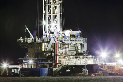 Hydraulic Fracturing site at night with lights on.