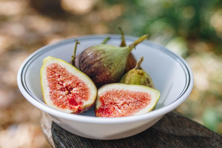 white bowl of cut figs