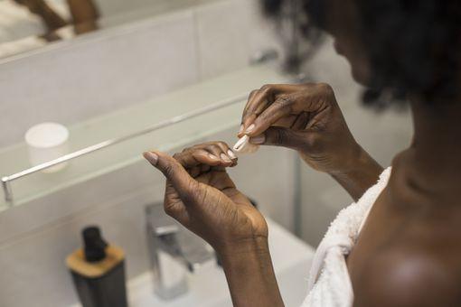 Woman removing nail polish