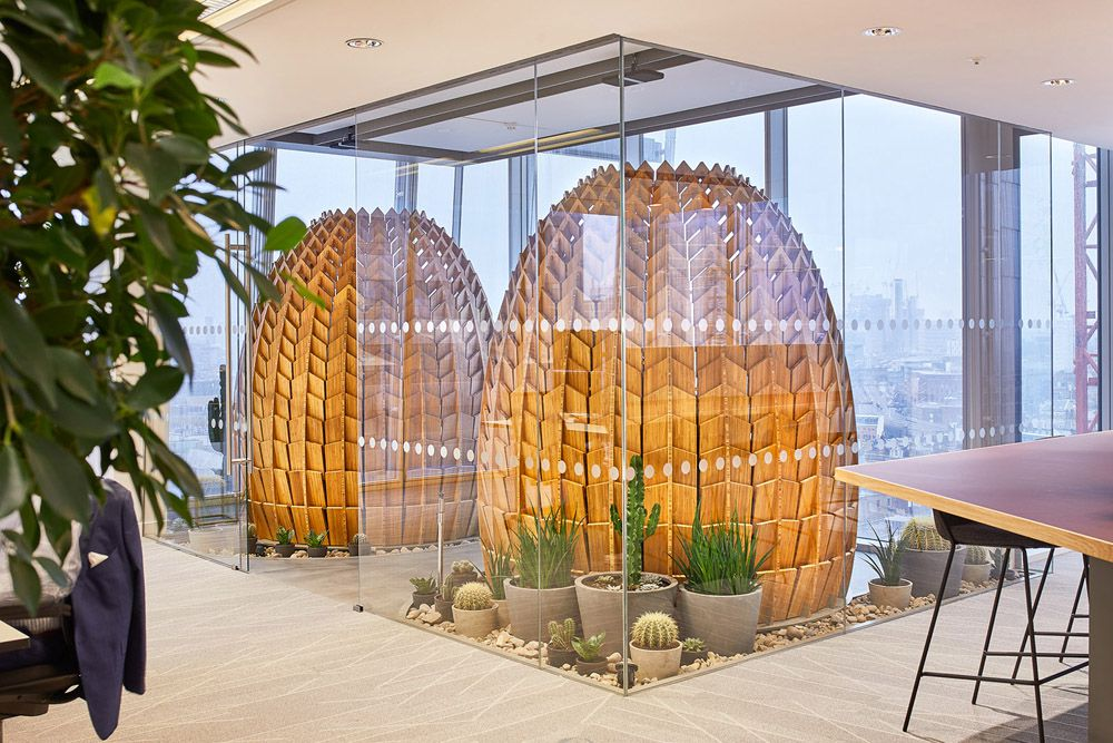 Wooden pods in a glass room