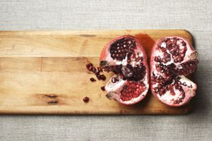 Halved pomegranate on a cutting board