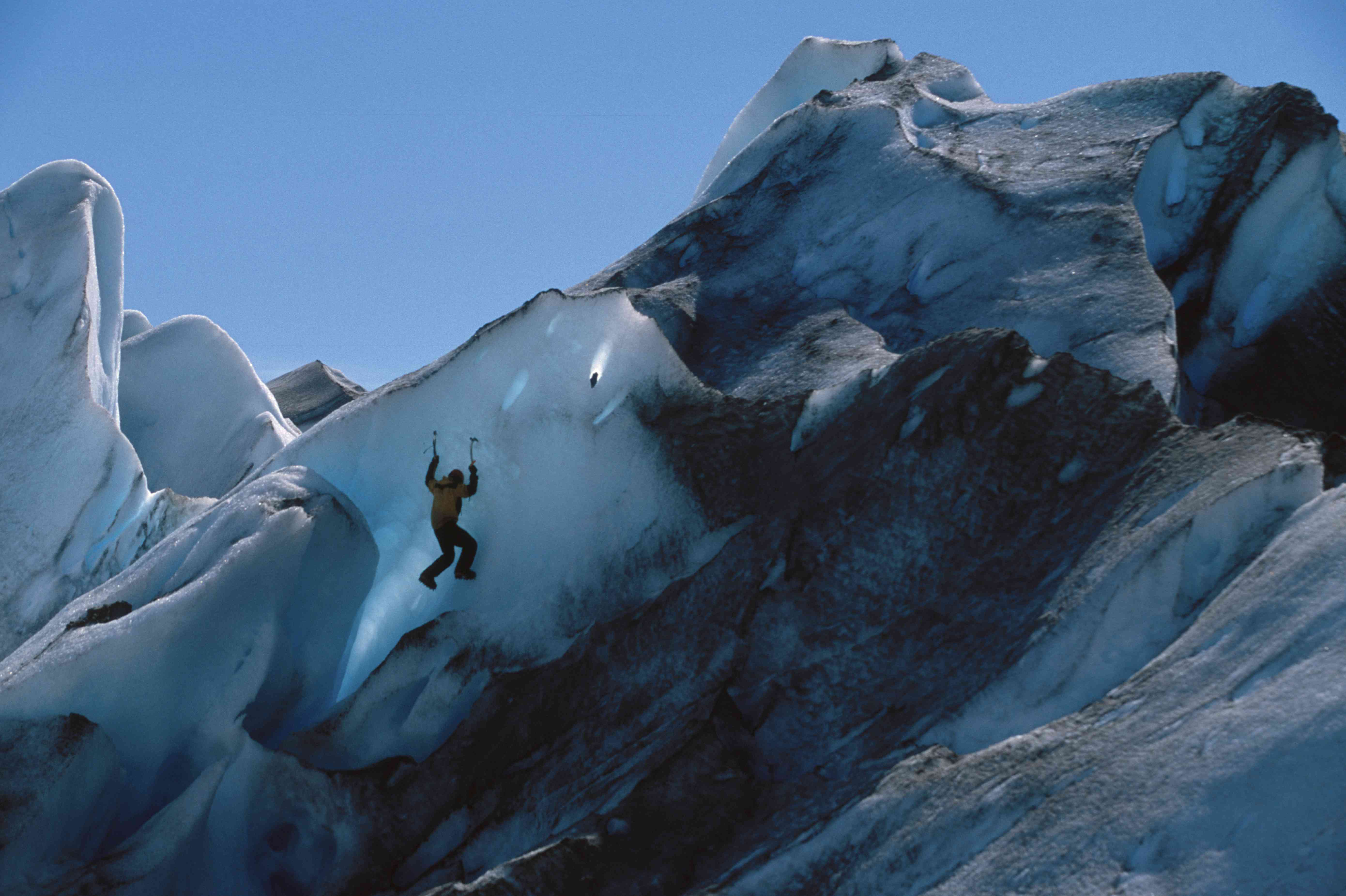 Ice climber on the bright-blue Viedma Glacier