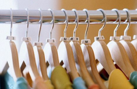 Clothes Hangers On a Rack Photo