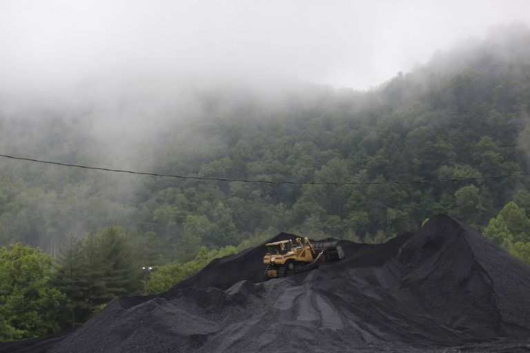 A bulldozer operates atop a coal mound at the CCI Energy Slones Branch Terminal June 3, 2014 in Shelbiana, Kentucky.