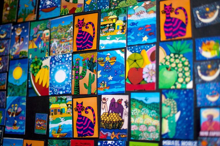 Postcards magnets on a wall