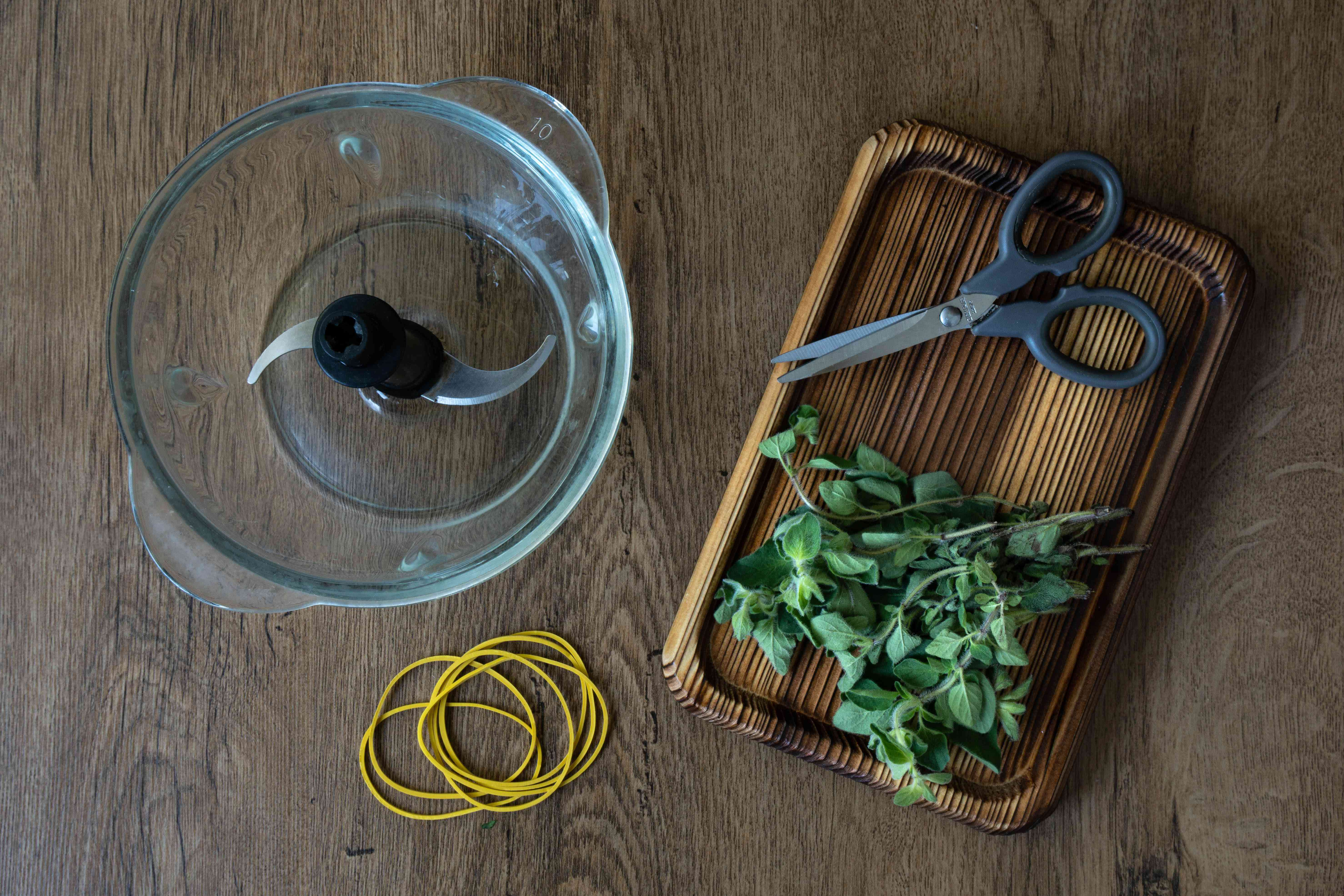 equipment needed to dry herbs includes scissors, rubber bands, and food processor
