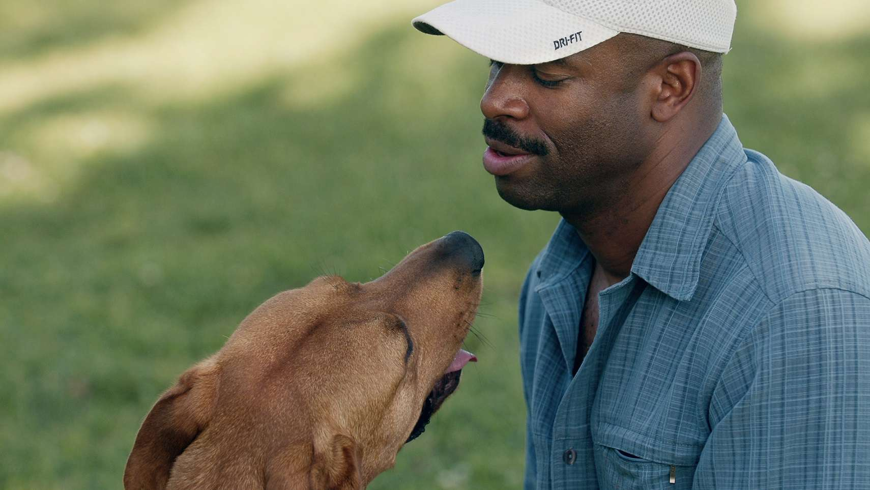 Leland Melvin with one of his dogs