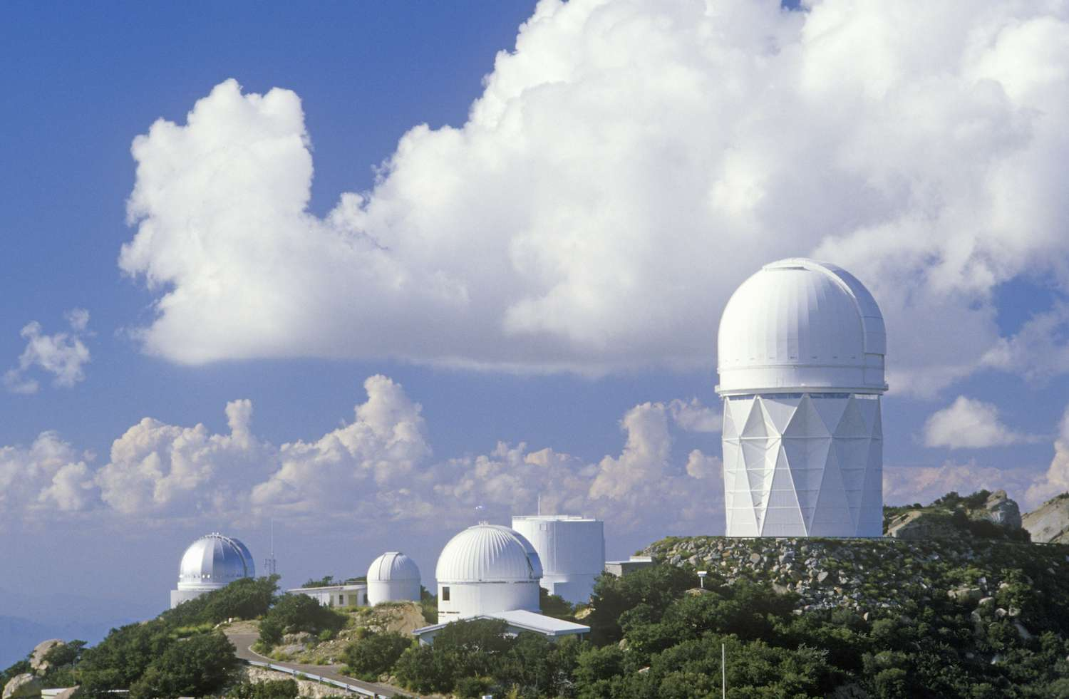 The collection of domes of Kitt Peak National Observatory on a cloudy day