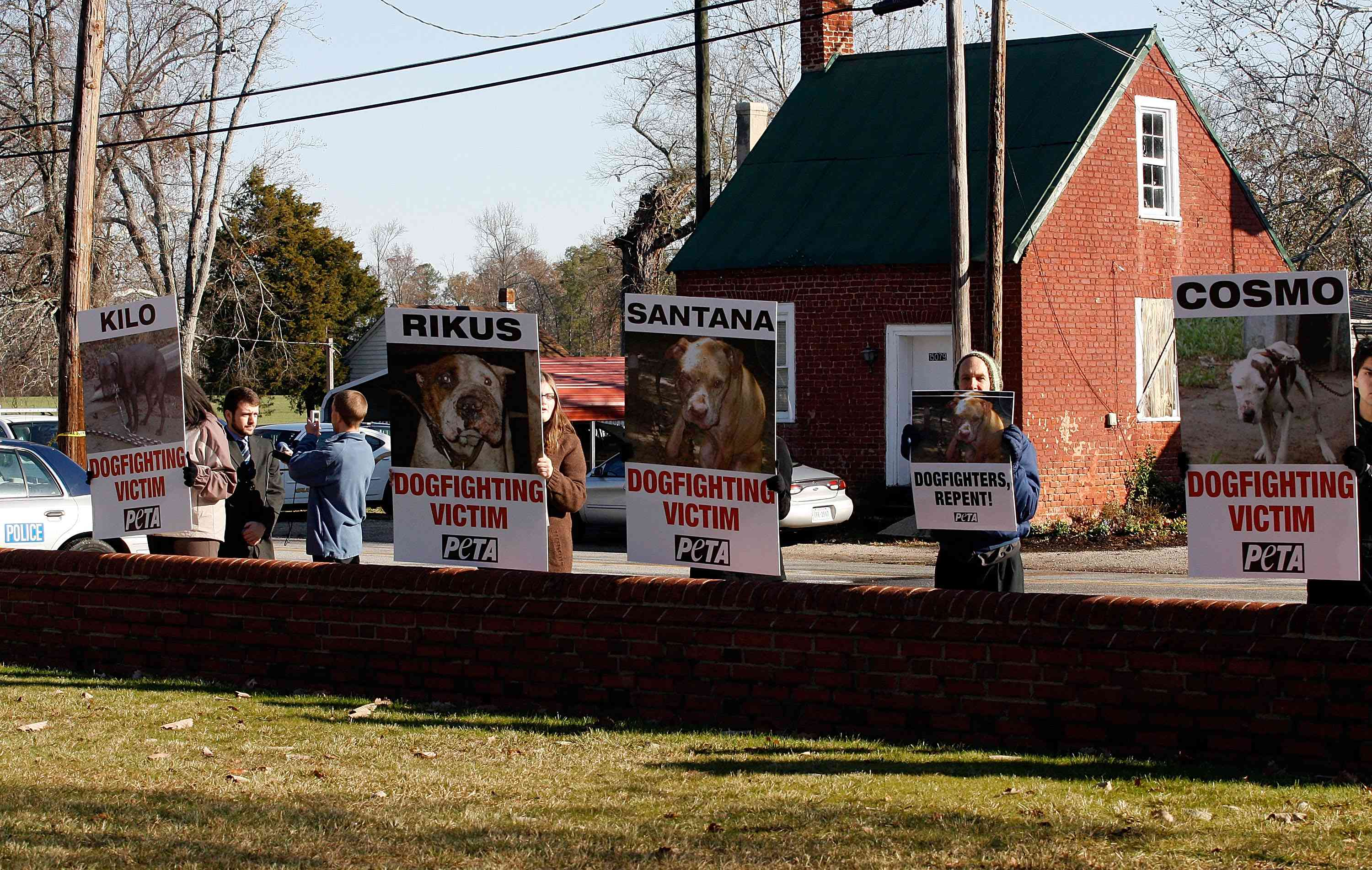 Protesters hold signs outside Surry County Circuit Court after Vick plead guilty on two felony counts on November 25, 2008 in Sussex, Virginia.