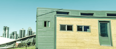 Side of a tiny house with a slide-out (currently stowed)