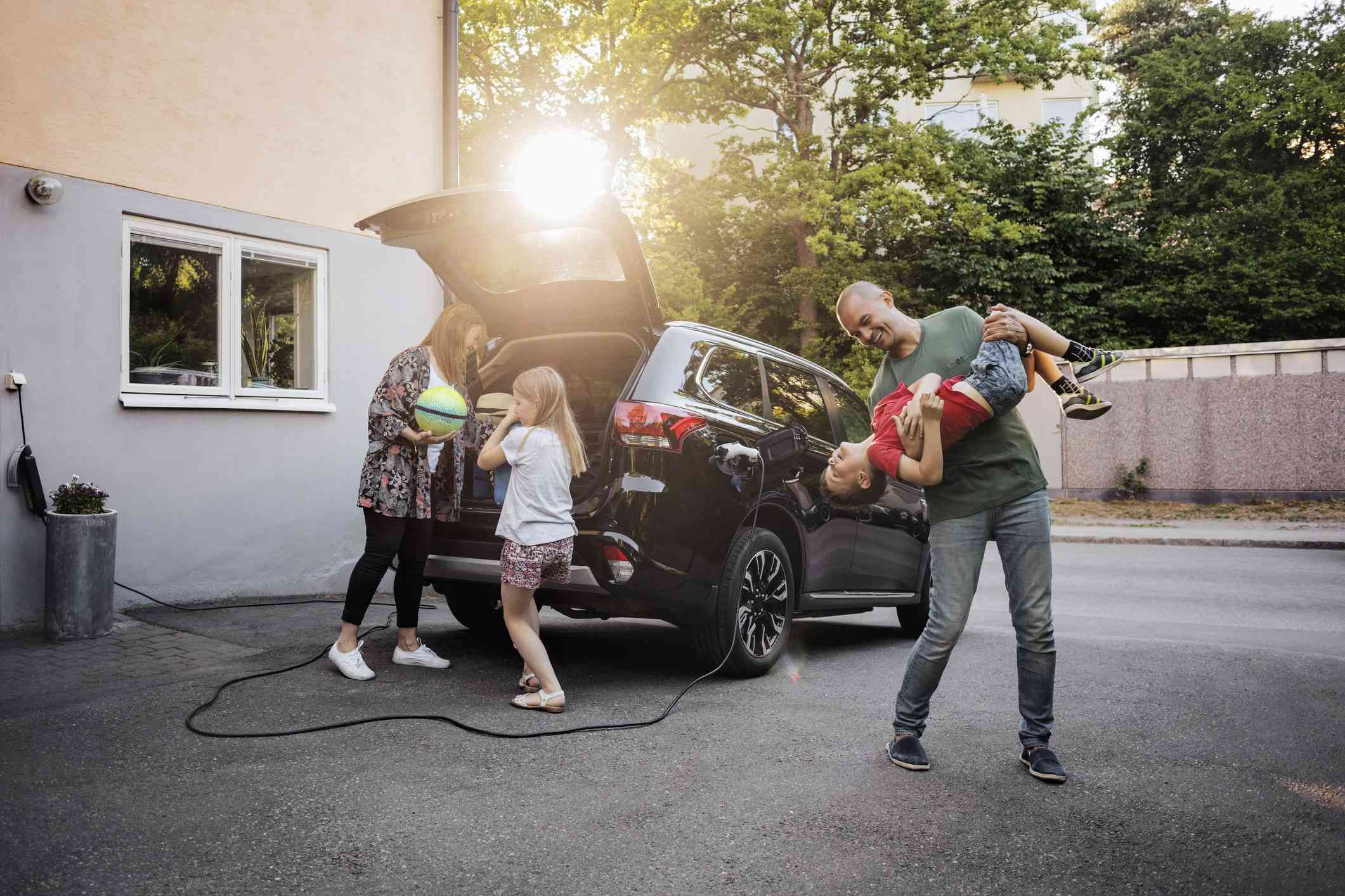 Family of four packing electric vehicle for a road trip