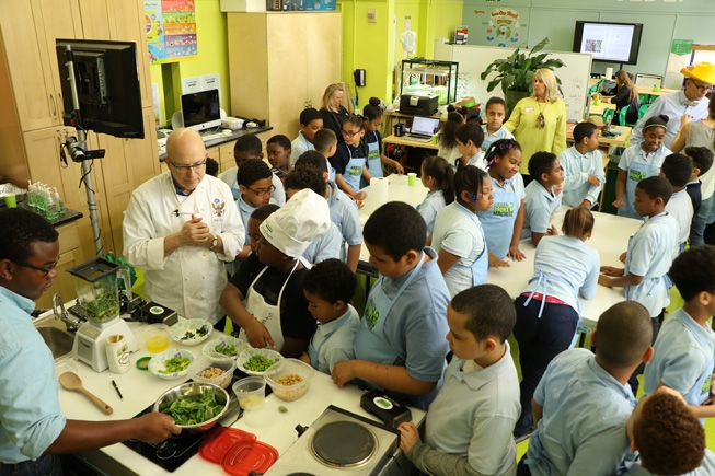Stephen Ritz in a classroom of students learning about produce