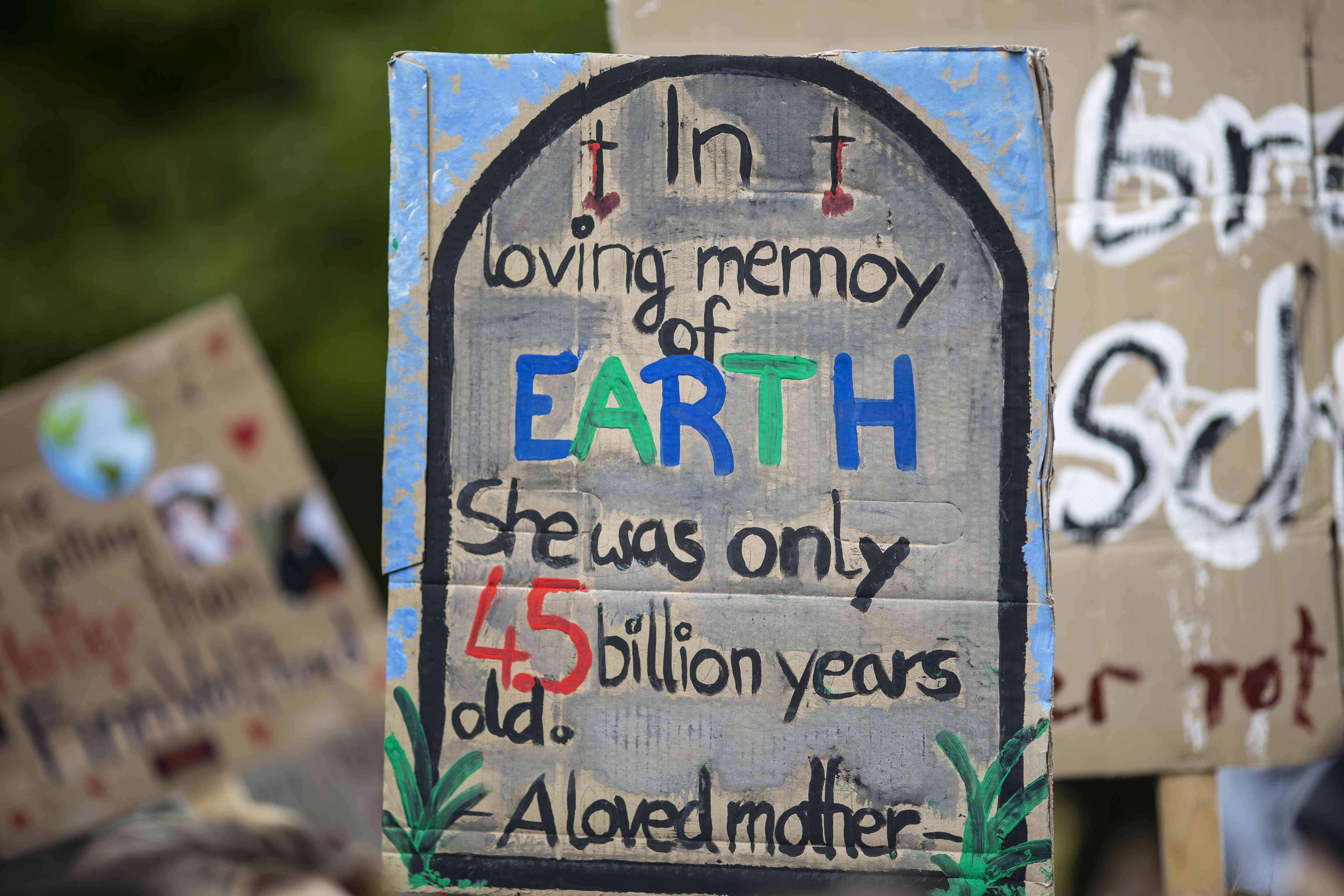 A protest sign from the Global Climate Strike on Sept 20 says: In loving memory of Earth. She was only 4.5 billion years old.
